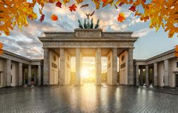 Autumn time in Berlin: the historical Brandeburger Tor Gate during sunset time stock image