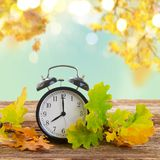Autumn time - fall leaves with clock Royalty Free Stock Photos