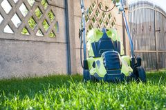 Lawn mowing / mowing the lawn Royalty Free Stock Images