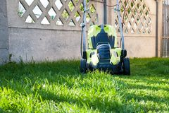 Lawn mowing / mowing the lawn Royalty Free Stock Image