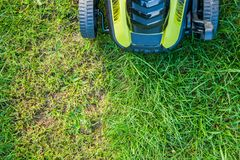 Lawn mowing / mowing the lawn Royalty Free Stock Photography