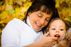 Autumn time - mother and child Stock Photography