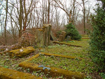 Autumn time in the old abandoned and ransacked Jewish cemetery. Open tombs, nobody care about this place Stock Photo