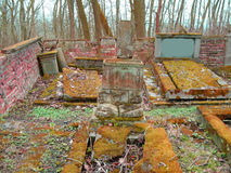 Autumn time in the old abandoned and ransacked Jewish cemetery. Open tombs, nobody care about this place Stock Photos