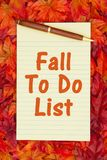 Autumn time To Do List with a yellow notepad and fall leaves Stock Image