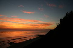 Autumn Tint Of Gold. Shot taken on a cliff of sun setting over the pacific stock photography