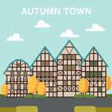Autumn town illustration with houses across the street and orang. Street with houses and orange trees Royalty Free Stock Photos