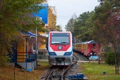 Autumn trains. Trains in the autumn park stock image