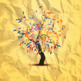 Autumn tree with beautiful flying leaves. Painted on crumpled paper Royalty Free Stock Photos