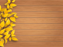 Autumn tree branch on weathered wooden background Royalty Free Stock Photos