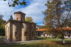 Autumn tree and church in  medieval  Zemen Monastery, Bulgaria Royalty Free Stock Photo