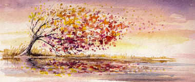 Autumn tree. On a wind.Picture created with watercolors Royalty Free Stock Image