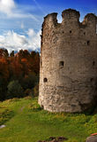 Autumn trees at  ancient destroyed fortress. Russia. Royalty Free Stock Images