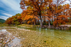 Autumn Trees on the Clear Gravely Frio River, Texas Stock Photo