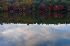 Autumn trees and clouds reflection on lake Royalty Free Stock Photography