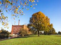 Autumn trees Mill Manchester UK Stock Photo