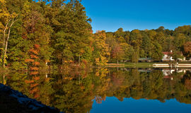 Autumn trees reflected on lake Stock Images