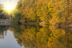 Autumn trees are reflected in the lake.  Stock Photo