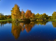 Autumn trees reflected in the water. Landscape with autumn trees reflected in the water stock photo