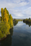 Autumn trees by a river Royalty Free Stock Photo