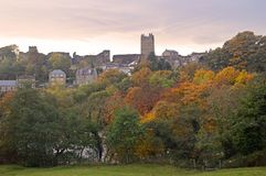Autumn trees by the river swale and richmond castle stock photos