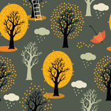 Autumn trees with yellow leaves, clouds and rain.  Royalty Free Stock Image