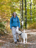 Autumn trekking with dog Royalty Free Stock Image