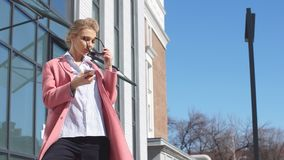 Autumn trend. Glamour beautiful girl holding her smartphone stock video footage
