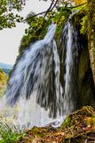 Autumn trip to Croatia, the park Plitvice Lakes. Picturesque splashing waterfall over the lake. The concept of ecological, active stock photography