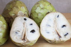 Autumn tropical fruits. Custard apple open and closed.Autumn tropical fruits Royalty Free Stock Images