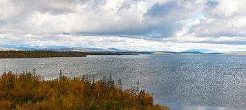 Autumn in tundra. Big lake in northern Scandinavia. Autumnal Lapland Stock Image