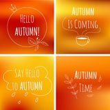 Autumn typography elements on orange blurred background with motivation text.  Stock Photo