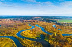Autumn valley. Fall meadow. Aerial landscape with river on a sunny autumn day. Sunny fall. Tranquil background. Rural scene stock images