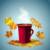 Autumn vector background. A cup of hot coffee or tea with autumn leaves Royalty Free Stock Images