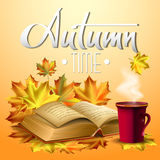 Autumn vector background with  leaves and cup of hot coffee or tea, old open book. Hand-written lettering. Stock Photo