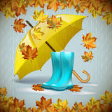 Autumn vector background with  leaves, yellow umbrella and rubber boots under the rain. Royalty Free Stock Images