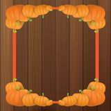 Autumn vector orange pumpkins border design template for banners and thanksgiving day backgrounds. Vector Pile of pumpkins frame laying on wooden table Royalty Free Stock Photography