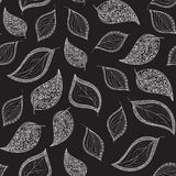 Autumn vector seamless pattern with figured lacy leaves on grey background. Autumn vector seamless pattern with figured lacy leaves. Endless decorative texture Stock Photos
