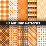 10 Autumn vector seamless patterns. Endless. Autumn vector seamless patterns. Set of halloween and thanksgiving geometric ornament. Orange and white colors Stock Photos