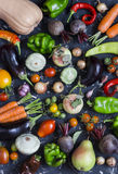 Autumn vegetable harvest. Assortment of vegetables - pumpkin, eggplant, peppers, carrots, tomatoes, onions, garlic, beets on a dar Stock Photo