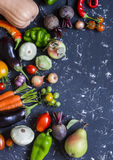 Autumn vegetable harvest. Pumpkin, eggplant, peppers, carrots, tomatoes, onions, garlic, beets on a dark background, top view. Royalty Free Stock Photos