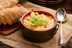 Autumn vegetable soup and baguette Royalty Free Stock Photo