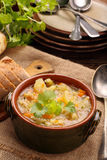 Autumn vegetable soup and baguette Royalty Free Stock Images