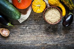 Autumn vegetables frame. Border of autumn vegetables on wooden background Stock Photo