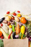 Autumn vegetables in shopping paper bag top view. royalty free stock photography