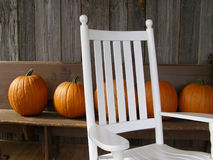 Autumn in Vermont. Front porch with rocking chair and pumpkins Stock Images