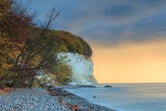 Autumn vibes on the chalk cliff on the baltic sea to the sunrise royalty free stock image