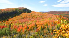 Autumn View. The North Shore in Autumn. Hills in foreground, body of water in background Stock Photos