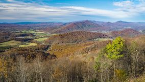 Autumn Colors in the Blue Ridge Mountains of Virginia, USA. An autumn view of a the beautiful colors in the mountains and valley under blue skies located in the royalty free stock photography