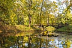 Autumn view of the bridge in Aleksandrovsk park. Bridge across canal in Alexander`s park in Tsarskoe Selo (Pushkin) Saint Petersburg Russia Stock Photo